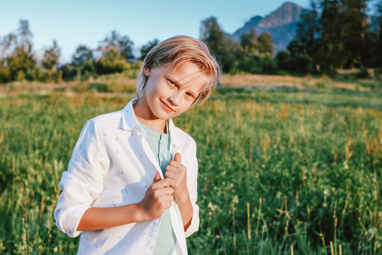 Portrait of boy standing on field