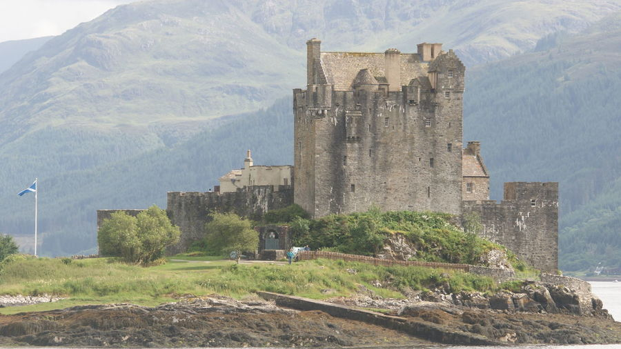 Castle on the Loch Scotland's Scenery Scotland History Castle Scotland Mountain Tree Castle History Architecture Sky Building Exterior Built Structure Tall - High