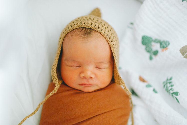A close up of a newborn sleeping baby. Closeup Hat Cute Newborn Sleeping Baby