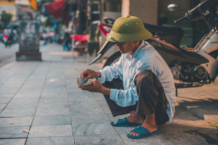 Asians and squats. Adult Hardhat  Headwear Helmet Men Occupation One Person People Protective Workwear Real People Senior Adult Senior Men Technology Touch Screen Wireless Technology Work Helmet Business Stories An Eye For Travel Love Yourself The Architect - 2018 EyeEm Awards