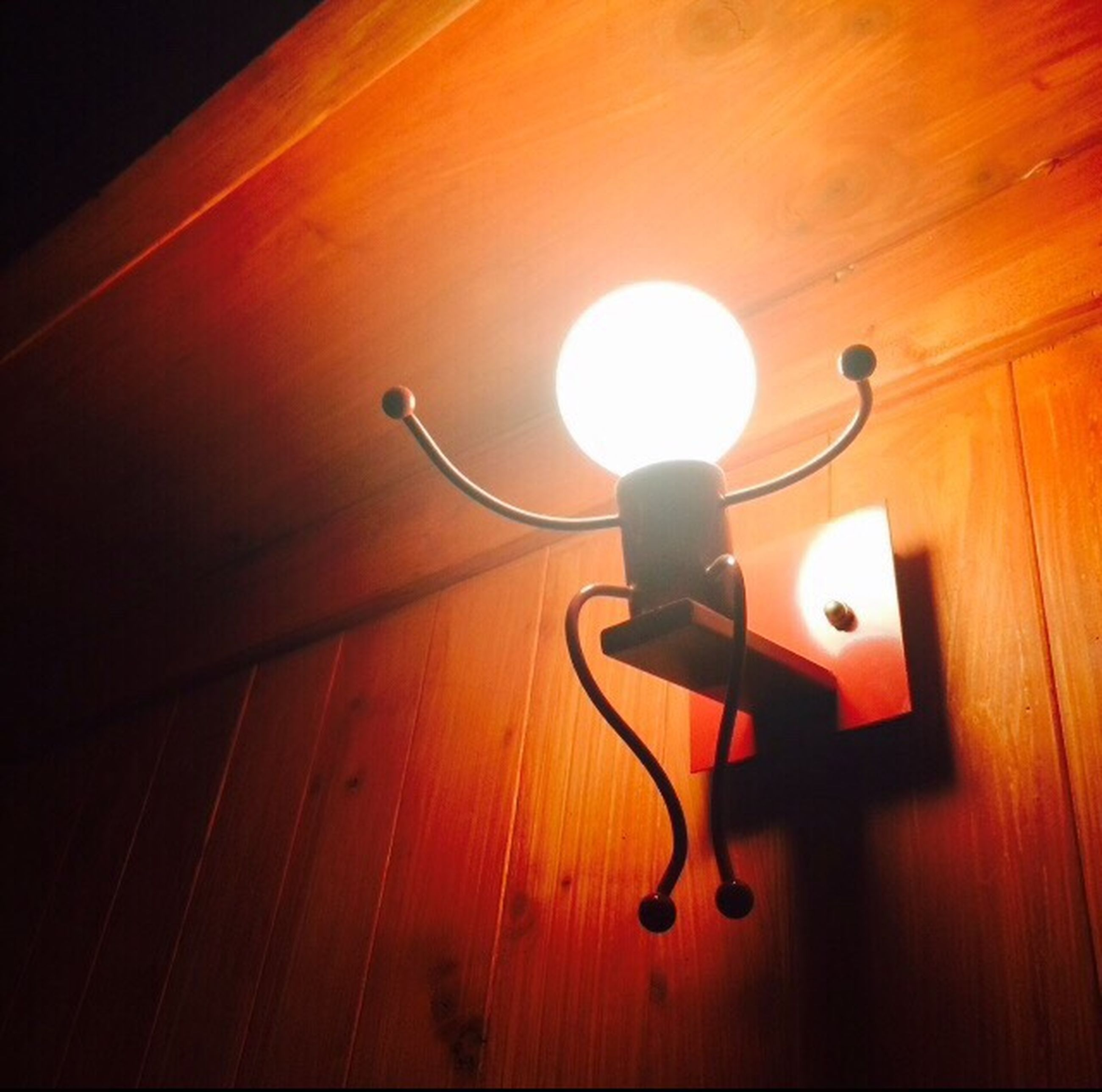 illuminated, indoors, lighting equipment, electricity, glowing, light - natural phenomenon, electric lamp, electric light, night, low angle view, wood - material, hanging, wall - building feature, lamp, lit, ceiling, light bulb, no people, light fixture, lantern