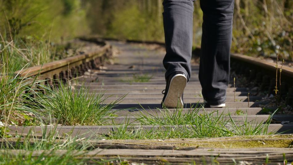 Leaving Low Section Human Body Part Human Leg Walking One Person Shoe Nature Outdoors Leisure Activity Close-up Grass Motion Adventure EyeEm Nature Lover Ladyphotographerofthemonth Long Goodbye Railway Track Leaving Distance Tranquil Scene Travel Travel Destinations Lonelyness Wodden Texture An Eye For Travel
