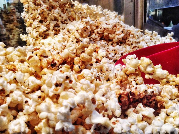 Freshly popped popcorn. Popcorn Snack Food Tasty Unhealthy Fattening Fresh Sweetened Salted