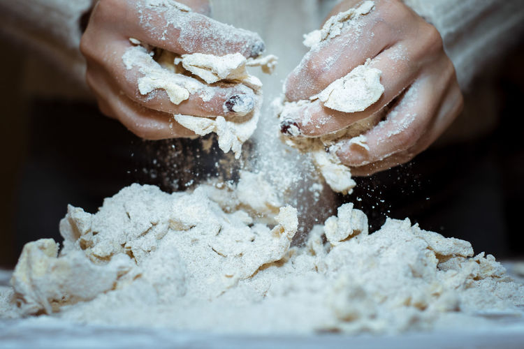 Cropped Image Of Kneading Dough