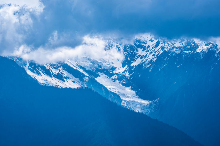 Beauty In Nature Scenics - Nature Cold Temperature Winter Nature Blue Cloud - Sky Snow Water Mountain Sea Tranquil Scene No People Day Environment Idyllic Tranquility Sky Outdoors Snowcapped Mountain Power In Nature Mountain Peak Meili DeQin Yunnan China Tibet Fog Cold Cool