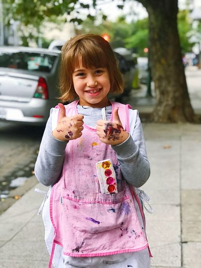 Elementary age Painteditmyself Little Girl Elementary Age One Person Smiling Women Happiness City Child Females Lifestyles Portrait Real People Street Childhood Three Quarter Length Looking At Camera Cheerful Outdoors