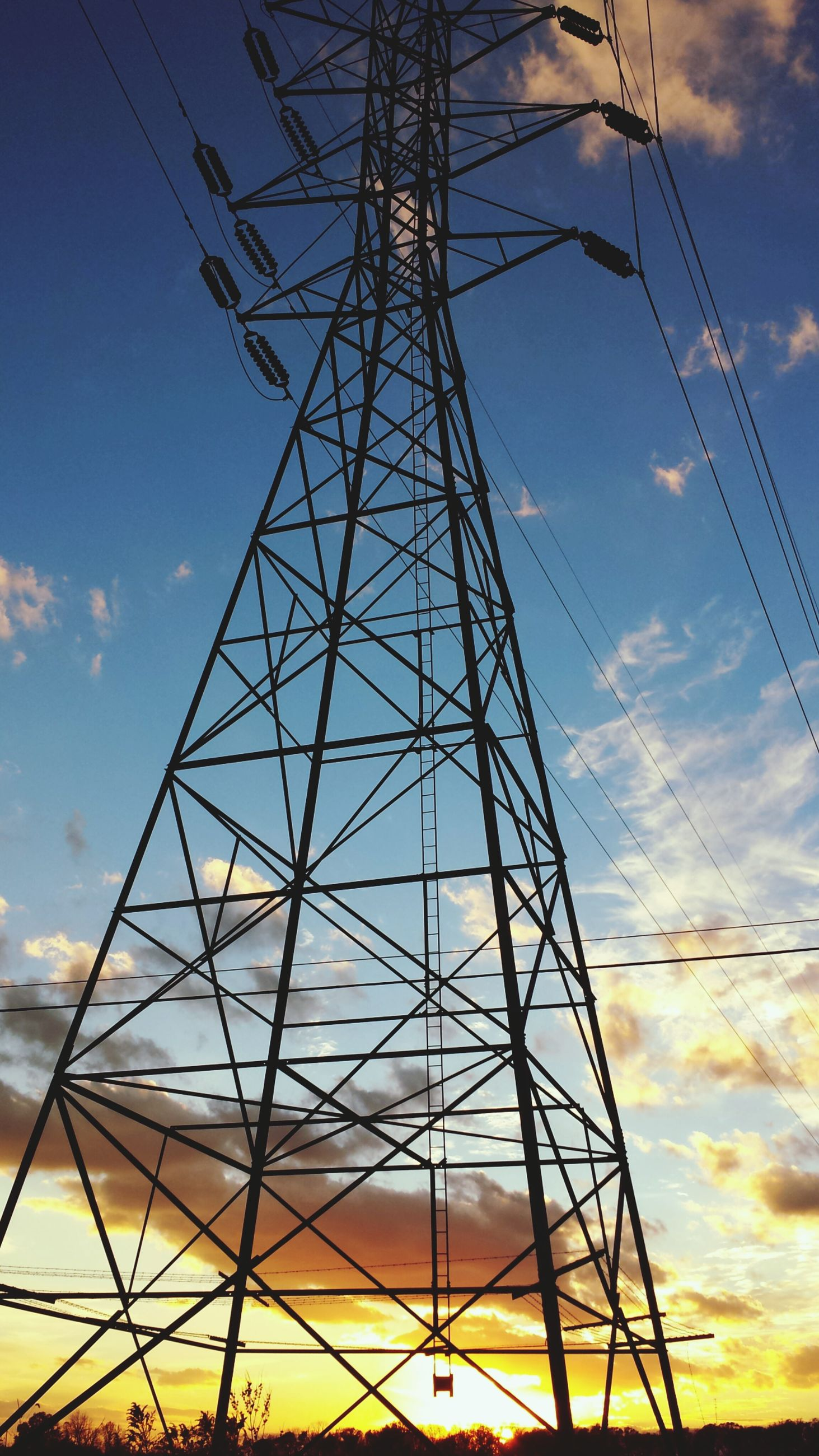 electricity pylon, low angle view, power line, power supply, fuel and power generation, electricity, connection, technology, sky, sunset, silhouette, cable, cloud - sky, complexity, electricity tower, cloud, outdoors, no people, nature, tall - high