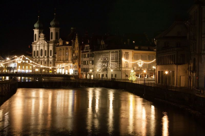 Canal and illuminated buildings at night