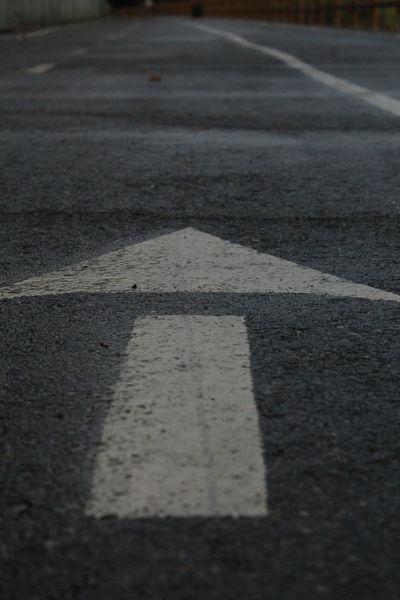 Arrow Arrow Symbol Asphalt Close-up Day No People Outdoors Road Road Marking Street Transportation