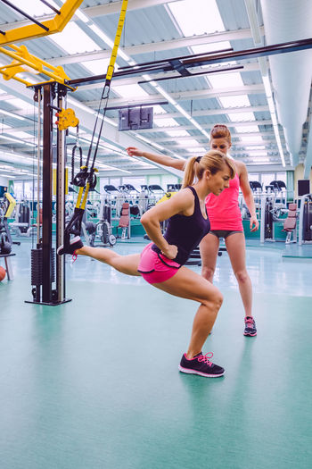 Women exercising with resistance band at gym