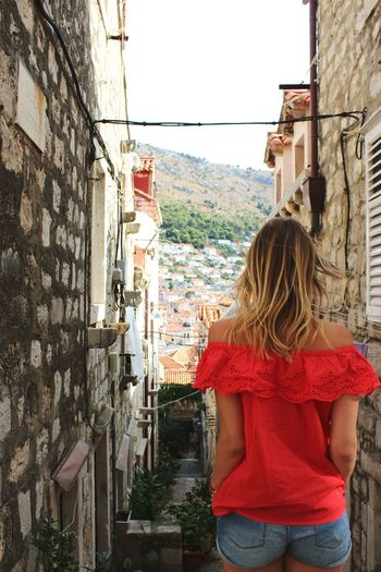 Dubrovnik ❤ Travel Travelgram Wanderlust Old Town Old Buildings Dubrovnik, Croatia Croatia Red Color City Women Portrait Blond Hair Standing Rear View Young Women Alley Long Hair Architecture Old Town Town International Women's Day 2019