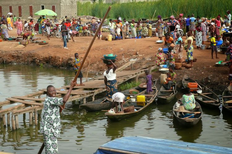 Africa African People Day Large Group Of People Leisure Activity Lifestyles Men Nature Nautical Vessel Occupation Outdoors People Real People River Standing Togetherness Transportation Travel Destinations Water Women