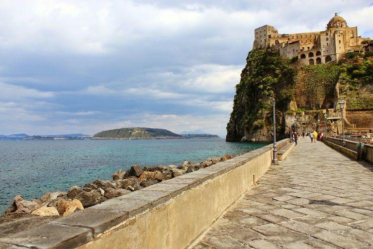 Pier in sea at ischia against sky