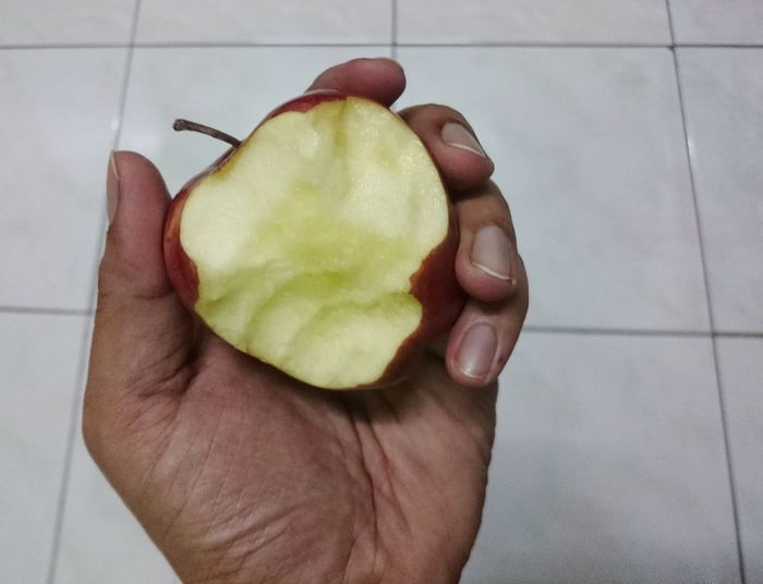 eating apple on hand Apple - Fruit Red Apple Hand Holding Apple Hold Healthy Eating Food And Drink Food Freshness Fruit High Angle View Human Hand Human Body Part Healthy Lifestyle Indoors  Directly Above One Man Only One Person Only Men Close-up People Ready-to-eat
