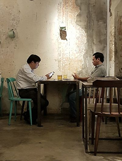 Ho Chi Minh City Vietnam Saigon Saigon Cafe Two People Table Indoors  Chair Food And Drink Sitting Full Length Young Adult Eating Young Men Men Drink Adult Young Women People Day Adults Only