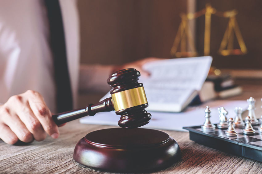 One Person Indoors  Focus On Foreground Human Hand Wood - Material Hand Human Body Part Holding Men Motion Consultant Counselor Fairness Barrister Gavel Balance Judgement Judge Lawyer Legal Legislation Verdict Inheritance Justice Chess