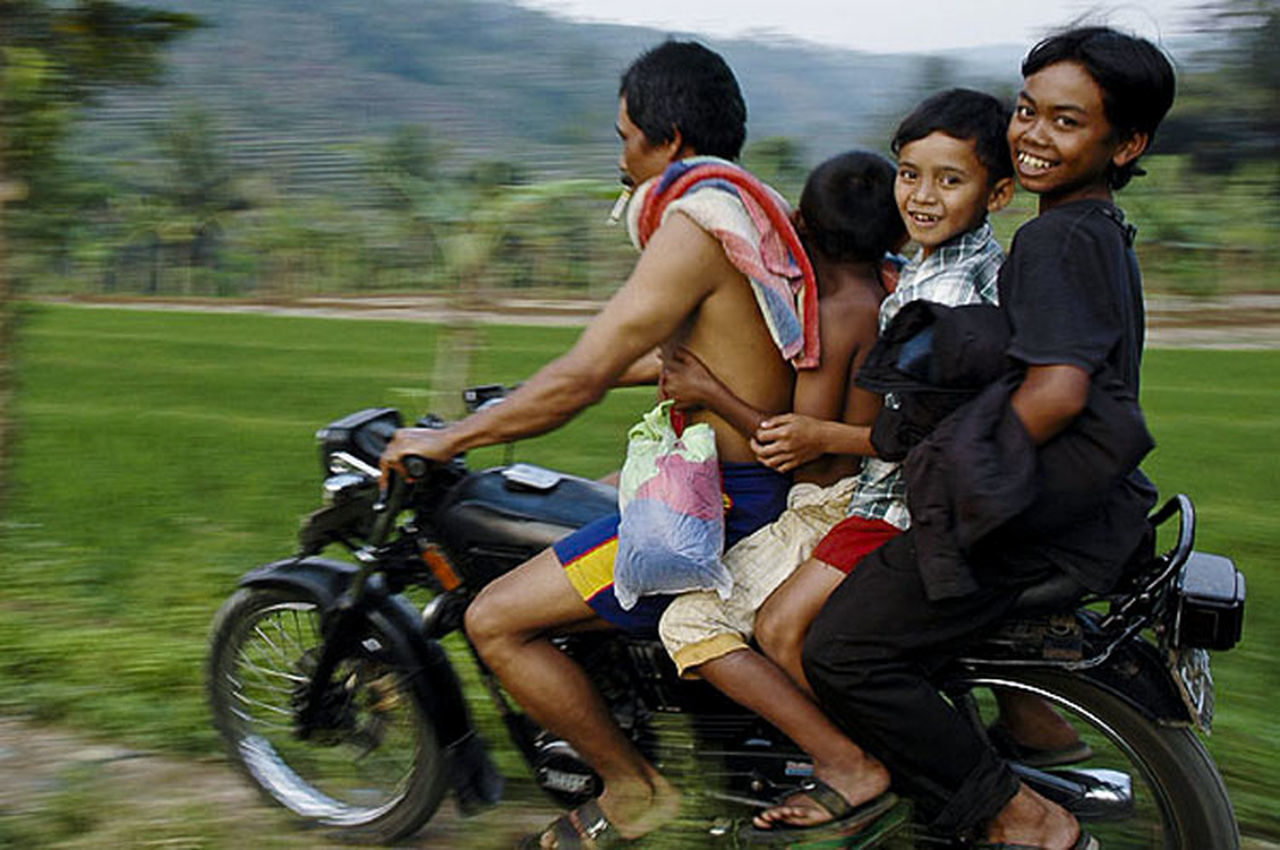 Family of four riding on motorcycle