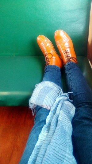 Travelling pair of boots. Boots Shawl Brown Boots Shoes On The Train