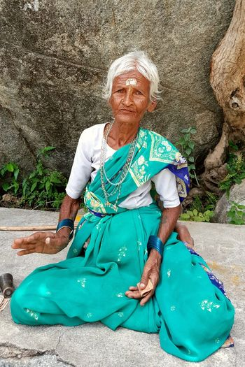Great Old Lady showers only blessings on You - She was 98 when we met her on 14th August 2017. Daily she used to climb hill-top up and down which contains an Lord Shiva temple, 1.5kms from the ground level. Place - Ardhagiri Sri Veeranjaneya Swamy Temple (ground), Aragonda village, Chittoor District (near Kanipakkam), Andhra Pradesh, India. She used to shower her blessings who are going and coming and she didn't begged but accepted the offerings given by the devotees. Great Human This Is Aging EyeEm Nature Lover EyeEm Gallery Eyeem Market Getty Images Getty+EyeEm Collection Gettyimagesgallery Getty Images Premium Collection EyeEm Selects EyeEm EyeEm The Best Shots EyeEm Masterclass Aging Aging Process Aging In Style Aged Woman Grandmother Grand Grandma Skin Wrinkles Wrinkles Around Eyes Chittoor Andhra Pradesh Blessing With Love Grandma Blessings Portrait Happiness Smiling Full Length Senior Adult Looking At Camera