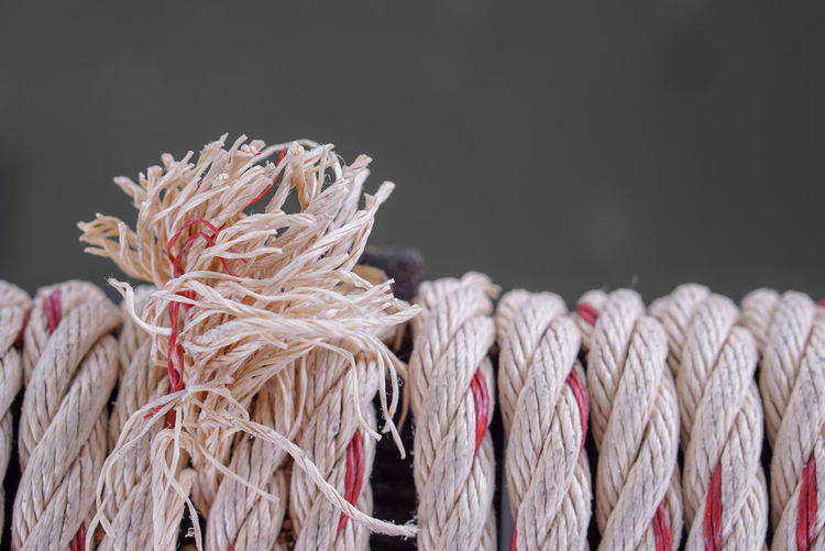 Close-Up Of Ropes Against On Gray Background