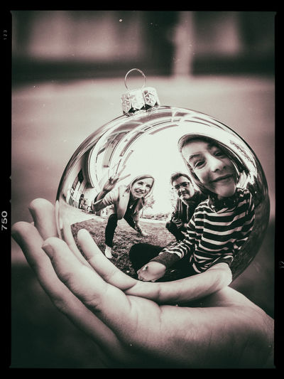 Transfer Print Real People One Person Auto Post Production Filter Holding Hand Human Body Part Human Hand Animal Wildlife Childhood Leisure Activity Focus On Foreground Lifestyles Representation Portrait Women Christmas Decoration Mirror Family