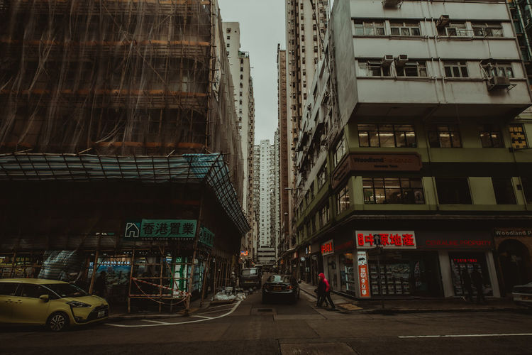 hongkong street Architecture Building Exterior City Built Structure Transportation Mode Of Transportation Car Motor Vehicle Building Street Land Vehicle Road Residential District City Life City Street Communication Outdoors No People Day Office Building Exterior Skyscraper HongKong