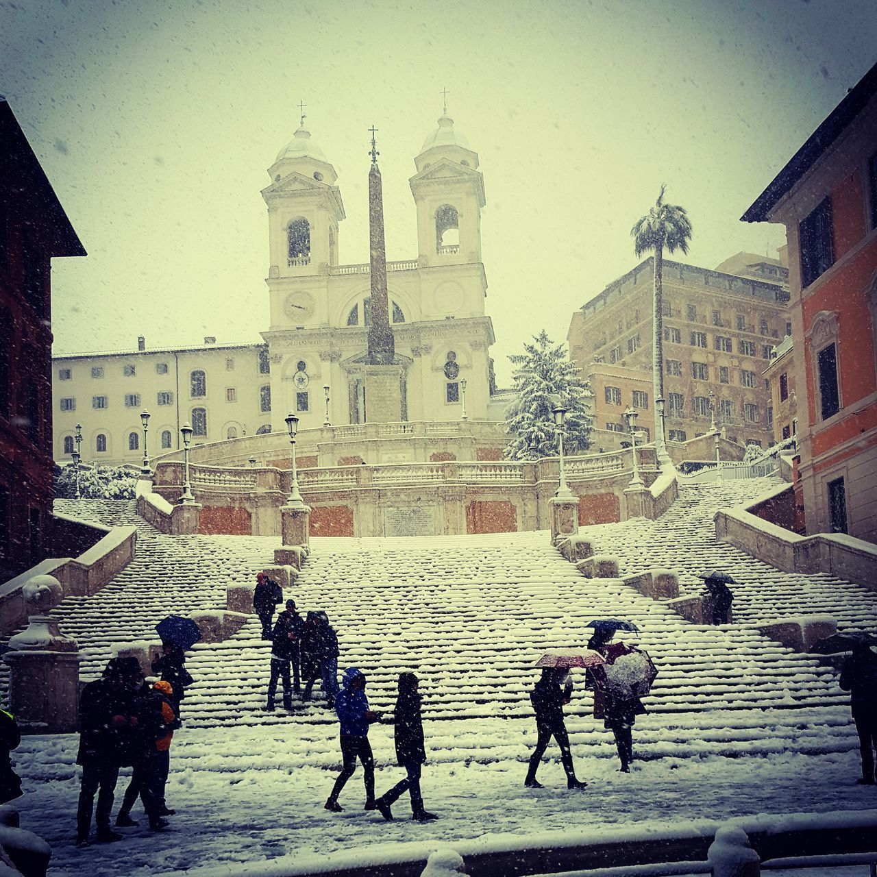 architecture, built structure, building exterior, group of people, building, real people, religion, place of worship, city, women, nature, belief, winter, sky, lifestyles, spirituality, large group of people, cold temperature, outdoors, snowing