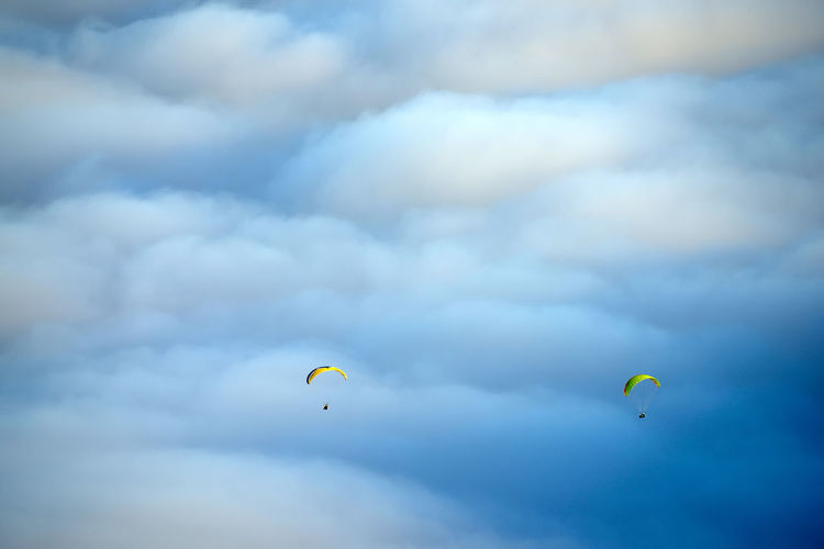 People paragliding over el teide national park
