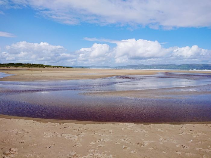 Benone beach after rain Northern Ireland Coastline Beauty In Nature Walks Tourism Nature Beaches Pristine Outstanding Natural Beauty Low Tide Water Sea Beach Sand Blue Summer Wave Sky