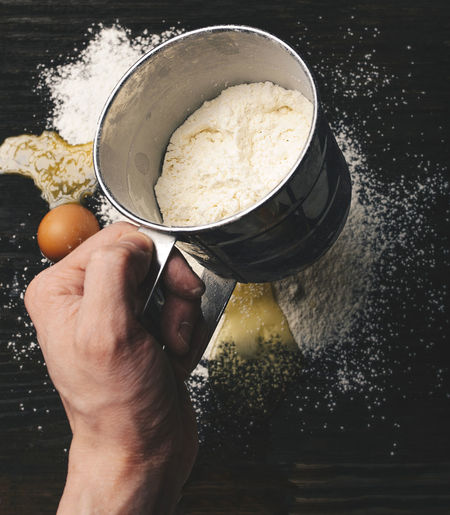 Human Hand Hand Food And Drink Human Body Part Real People One Person Holding Food Freshness Preparation  Lifestyles Kitchen Utensil Men Indoors  Preparing Food Sweet Food High Angle View Leisure Activity Flour Body Part Finger Analogue Sound