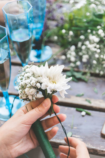 Flower Wreath Human Hand Hand Holding Human Body Part Real People Flower Flowering Plant One Person Freshness Lifestyles Focus On Foreground Body Part Leisure Activity Nature Plant Day Personal Perspective Unrecognizable Person Women Finger Glass Outdoors Flower Head Human Limb