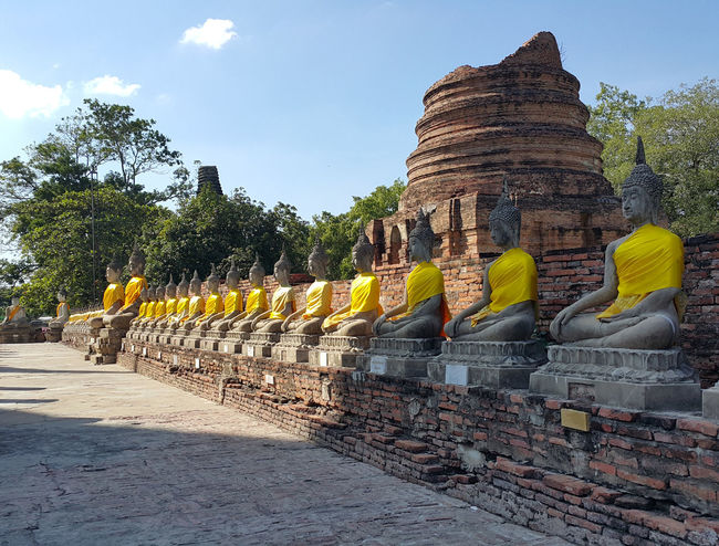 Wat Yai Chai Mongkhon Art Art And Craft Ayutthaya Buddha Buddha Statue Colorful Creativity History Multi Colored Outdoors Pagoda Respect Sacred Sacred Places Sunny Temple The Past Tranquil Scene Tranquility Travel Destinations Wat Yai Chai Mongkhon Weathered Yellow Robe