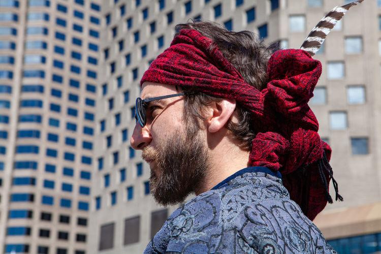 Portrait of man with umbrella in city