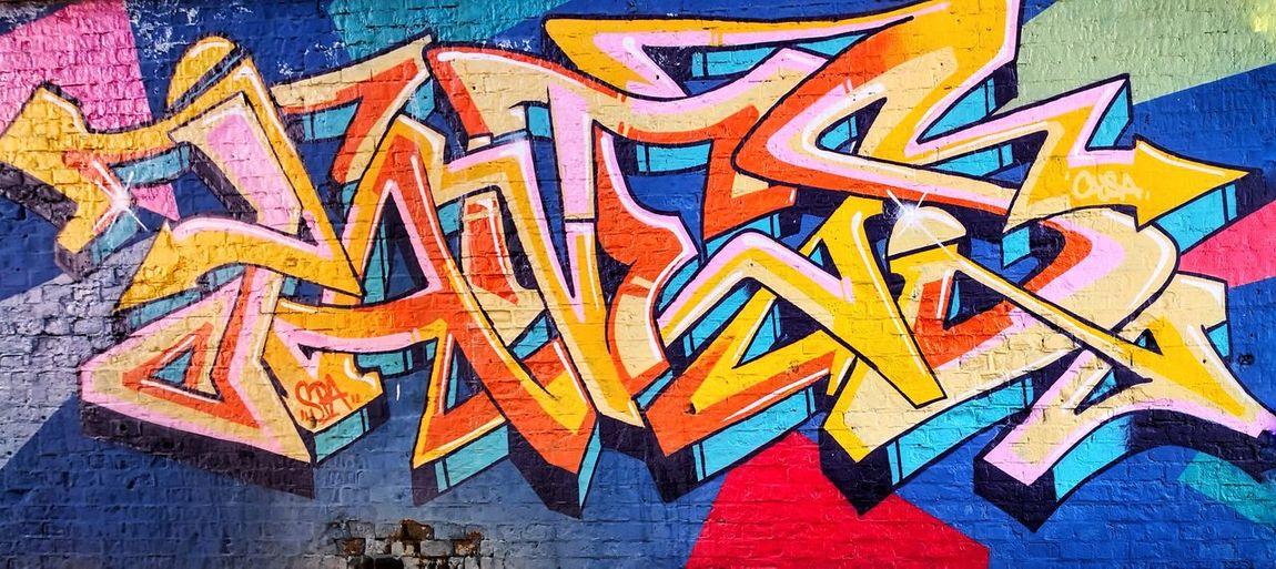 Bologna, Italy EyeEm Selects Bologna Modern Tags Eyeem Art Multi Colored Backgrounds Full Frame Communication Close-up Street Art Graffiti Mural Spray Paint Spray Bottle