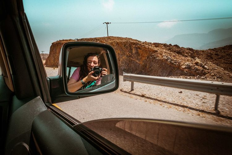 Oman Chapters Transportation Mode Of Transportation Land Vehicle Real People Car Vehicle Interior Motor Vehicle Reflection Sky Side-view Mirror One Person Day Glass - Material Young Adult Window Portrait Nature Travel Sitting Lifestyles Outdoors Road Trip