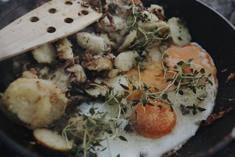 Cooking fried potatoes and eggs over open fire Stock Outdoor Kitchen Fried Potatoes With Egg Kitchen Cooking Camping Food And Drink Food Campfire Cooking Camping Outdoors Nature Travel Destinations Wilderness Norway Bondire Cooking Over Fire Freshness Close-up Wellbeing No People Healthy Eating High Angle View Ready-to-eat Indoors  Vegetable Still Life Kitchen Utensil Serving Size Indulgence Meat Household Equipment Meal Seafood Plate Herb Chopped Temptation The Foodie - 2019 EyeEm Awards