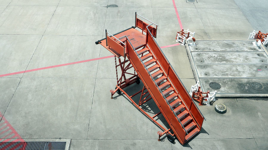 High angle view of red staircase at airport