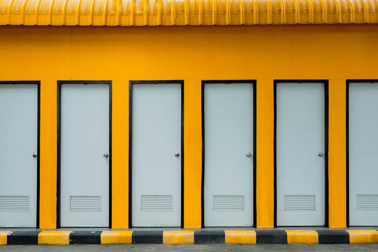 Full frame shot of yellow toilet door
