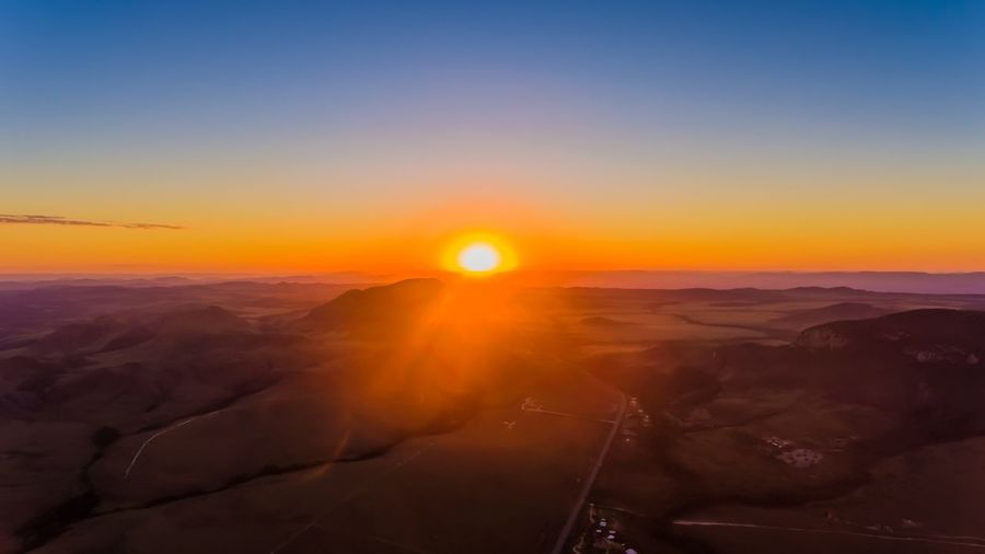 Sunset chapada dos Veadeiros Sky Sunset Beauty In Nature Scenics - Nature Sun Landscape Environment Nature Tranquility Tranquil Scene Non-urban Scene Sunlight Orange Color Lens Flare Travel No People Outdoors Clear Sky