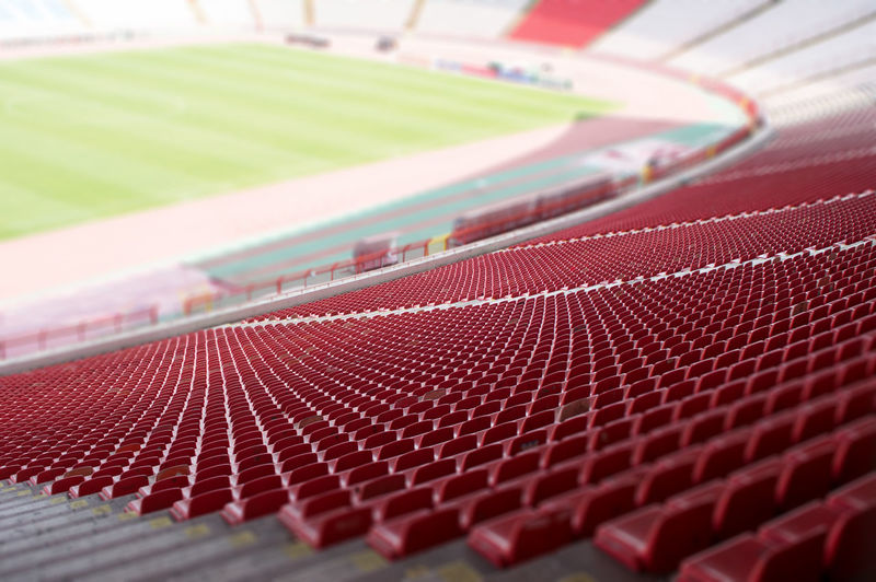 red seats at the stadium Sport Close-up No People Red Pattern Textured  Competition Number Business Stadium Sports Track Detail Seats Rows Plastic Soccer Game Football Event Public Field Section Team Seating Empty
