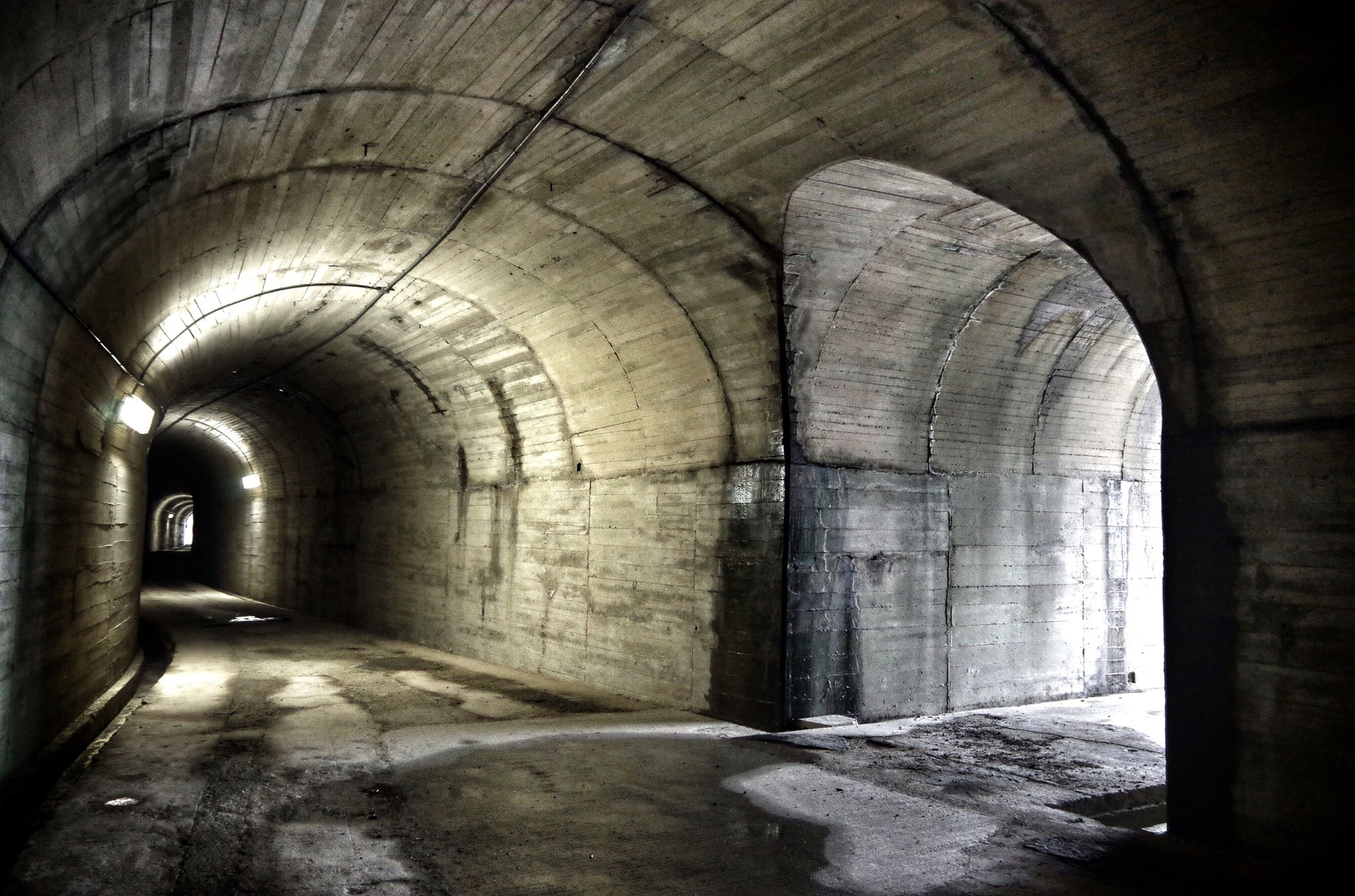 indoors, arch, architecture, built structure, interior, old, ceiling, tunnel, the way forward, corridor, archway, history, abandoned, architectural column, building, wall - building feature, diminishing perspective, no people, historic, arched