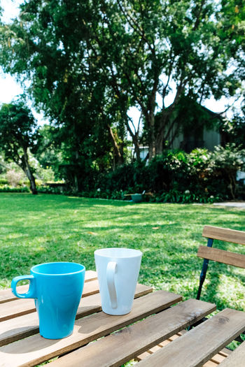 Empty coffee cup on table in park