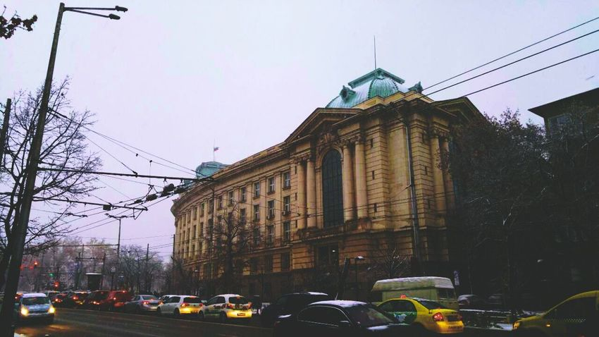 Architecture City Car Transportation Outdoors Building Exterior Day Sky Freshness Snowflake ❄ View Cars Winter Snow ❄ Snowing Colorful Colors Snowing Winter 2017 Winter Time Traffic Control Transportation Traffic Traffic Lights Architecture Sofia University