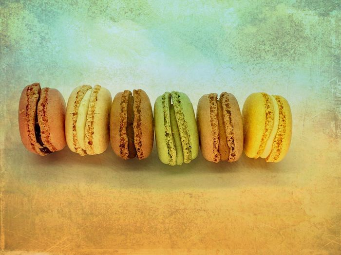 Macaroon Macarons Food And Drink Food Sweet Food Still Life Indoors  Text Freshness Side By Side Sweet Indulgence No People Studio Shot Arrangement Dessert Group Of Objects Directly Above Close-up Celebration Temptation Baked