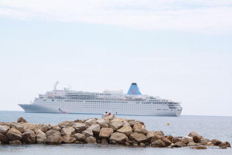 Nautical vessel on sea shore against sky