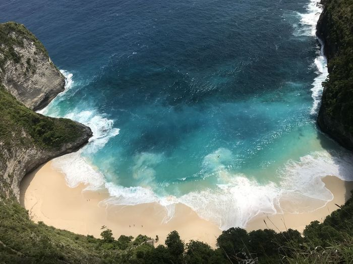 Kelingking Beach at Nusa Penida Island, Bali, Indonesia Blue Ocean Beach Beauty In Nature Blue Day High Angle View Idyllic Kelingking Beach Land Motion Nature No People Nusa Penida Outdoors Power In Nature Rock Scenics - Nature Sea Seascape Sport Tranquil Scene Tranquility Turquoise Colored Water Wave First Eyeem Photo My Best Travel Photo