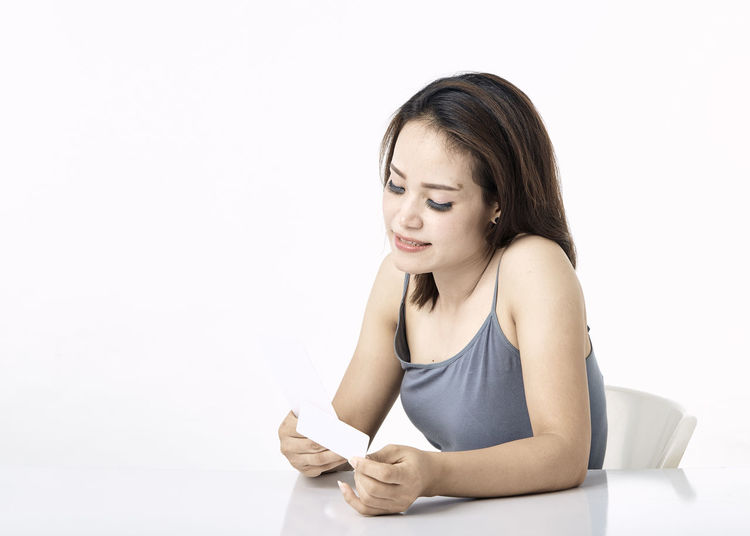 Thai Studio Shot 30-34 Years Shopping Online  Young Female Happy Asian  Laptop Beautiful Internet Attractive Smile person Computer People Portrait Holding Phone Beauty Mobile Pretty Technology Payment Adult Using Lifestyle Cheerful Purchase Business Wireless Lady Chinese Fashion Looking Smartphone Japanese  Korean Credit Card Empty Text Copy Space One Person White Background Indoors  Women Young Women Writing Publication Waist Up Young Adult Book Education Learning Front View Casual Clothing Sitting Note Pad Beautiful Woman Hairstyle Studying Contemplation