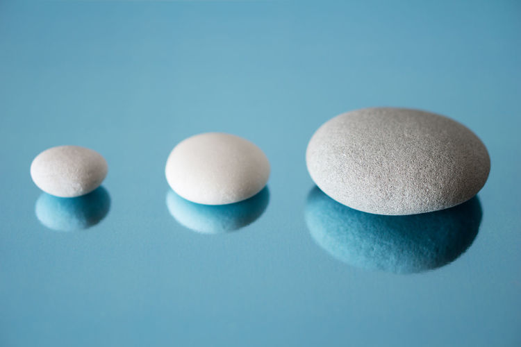 Close-up of medicines over blue background