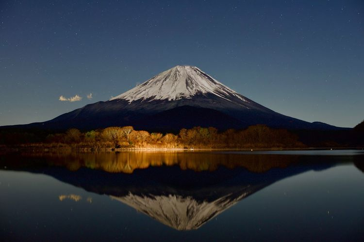 Fuji Mountain Mountain Scenics - Nature Night Sky Water Reflection Beauty In Nature Lake Tranquility Tranquil Scene Star - Space Volcano Snow Mountain Peak Cold Temperature Astronomy Landscape Nature