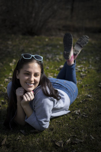 EyeEm Selects Cheerful Day Full Length Grass Happiness Leisure Activity Lifestyles Lying Down One Person Outdoors People Portrait Real People Smiling Young Adult Young Women